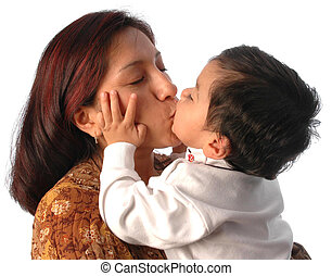 hispanic mother kissing her son