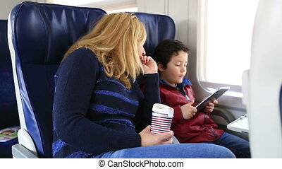 mother and son in a train