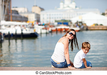 Mother and son in city center Helsinki Finland