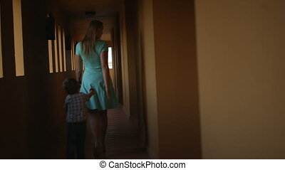 Mother and son in hotel hall