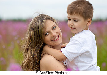 Mother and son in meadow outdoor