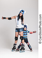 Mother and son in roller skates