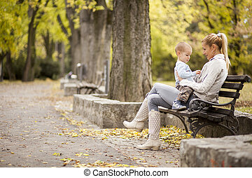 Mother and son in the autumn forest