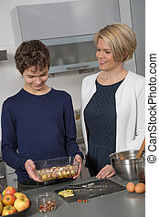 Mother and Son in the kitchen
