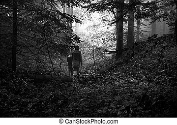 Mother and son in the mystic green foggy forest