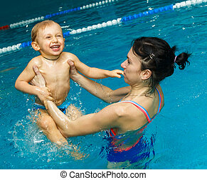 Mother and son in the pool