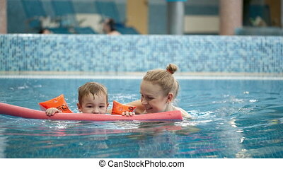 Mother and son in the swimming pool