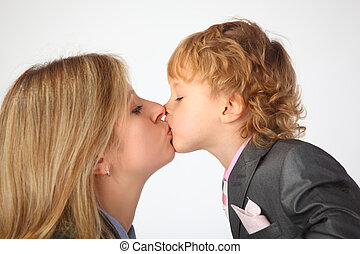 Mother and son kiss