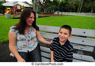 mother and son laughing while at park