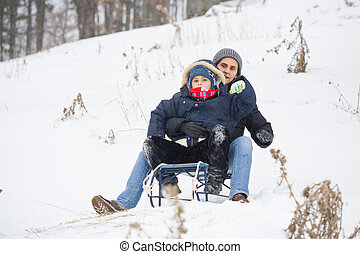Mother and son on a sledge