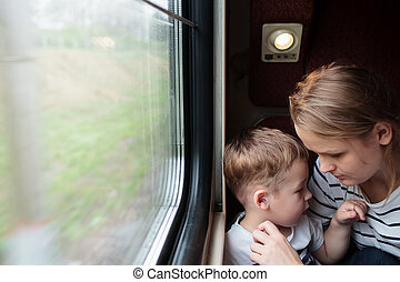 Mother and son on a train trip