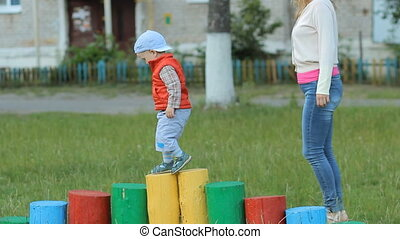 Mother and son on the Playground, play with children's constructions