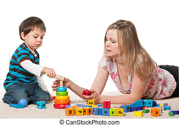 Mother and son play with blocks