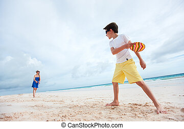 Mother and son playing frisbee