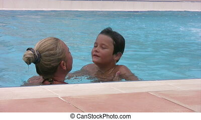Mother and son playing in the swimm