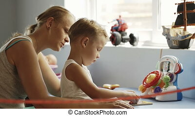 Mother and son playing learning game