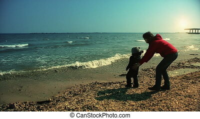 Mother and son playing on the sea