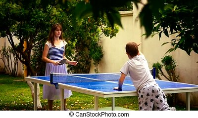 Mother and son playing table tennis