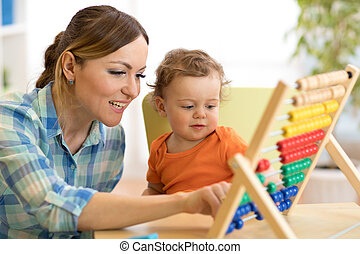 mother and son playing with abacus, early education