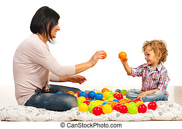Mother and son playing with balls