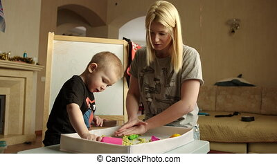 Mother and Son Playing with Kinetic Sand