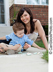 Mother and Son Playing with Sidewalk Chalk