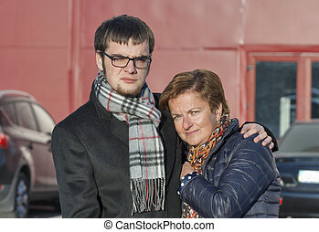 mother and son portrait in autumn clothing
