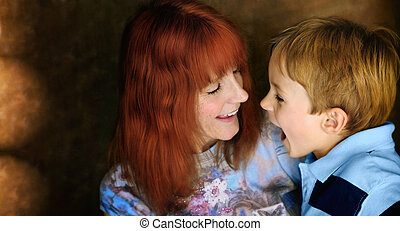 Portrait of mother and son laughing together