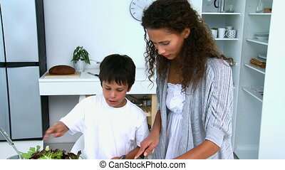 Mother and son preparing a salad