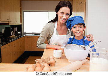 Mother and son preparing cake