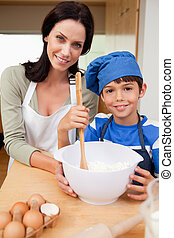 Mother and son preparing cookies