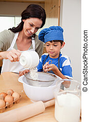 Mother and son preparing dough