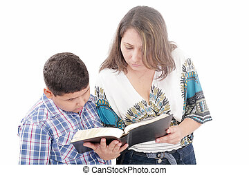 Mother and son reading a Bible over a black background