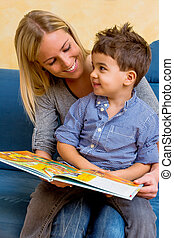 mother and son reading a book, symbol of maternal love, ...