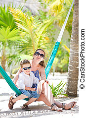 Mother and son relaxing in hammock