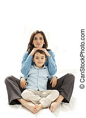 mother and son sitting on floor