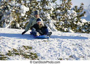 Mother and Son Sledding down the Hill