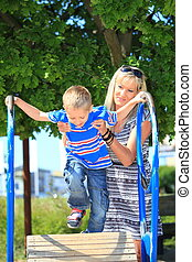 Mother and son together at the playground