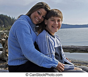 mother and son together on beach - mother and son together ...