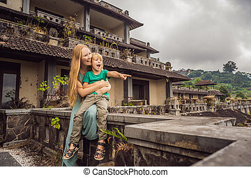 mother and son tourists in abandoned and mysterious hotel in...