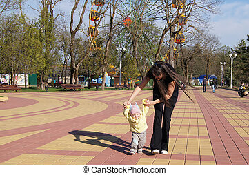 Mother and son walking in the park