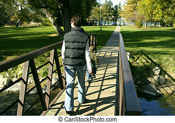 Mother and Son walking on the Park Bridge