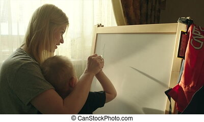 Mother and Son Writing Numbers on the Marker Board