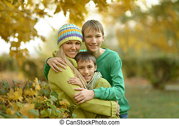 Mother and sons in park