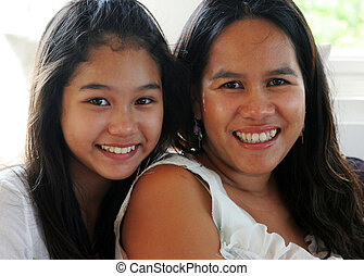 Mother and teenaged daughter - Happy Asian family - mother...