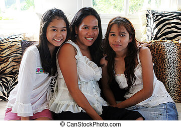 Mother and teenaged daughters - Happy Asian family - mother...