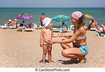 Mother and the child on a beach.