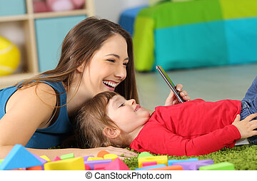 Mother and toddler playing with a smart phone