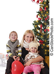 Mother and two children having fun at Christmas