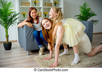 Mother and two daughters fooling around